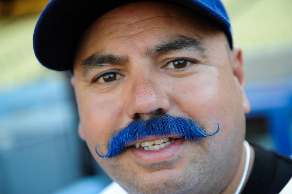 . Rudy Mayorga, from Huntington Beach, sports the blue mustache at the Dodgers-Rockies game, Friday, July 12, 2013, at Dodger Stadium. (Michael Owen Baker/Staff Photographer)