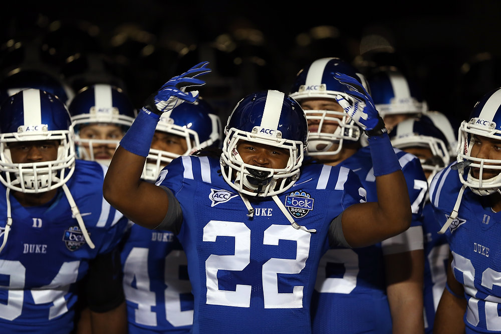 Description of . Britton Grier #22 of the Duke Blue Devils prepares to run onto the field before their game against the Cincinnati Bearcats at Bank of America Stadium on December 27, 2012 in Charlotte, North Carolina.  (Photo by Streeter Lecka/Getty Images)