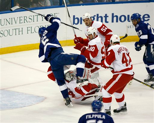 . Tampa Bay Lightning defenseman Anton Stralman (6) collides with Detroit Red Wings goalie Petr Mrazek (34) during the first period of Game 1 of an NHL hockey first-round playoff series, Thursday, April 16, 2015, in Tampa, Fla. (Douglas R. Clifford/Tampa Bay Times via AP)