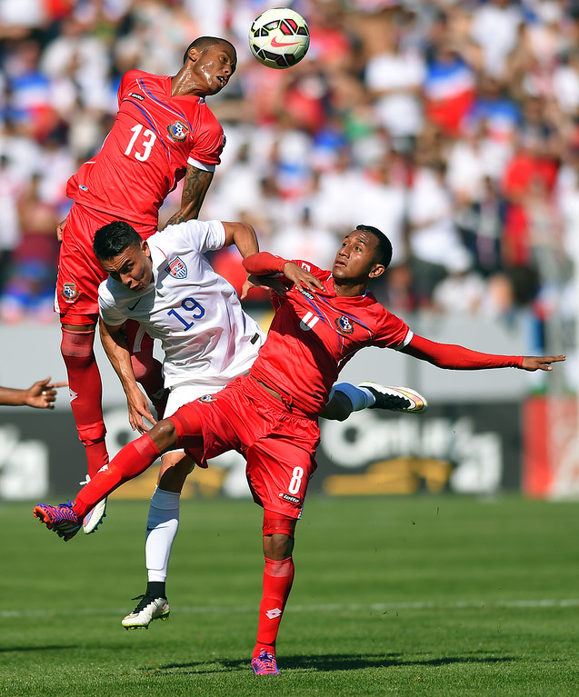 . Panama�s Alfredo Stephens, left, clears the ball away from USA�s Miguel Ibarra, center, and teammate Marcos Sanchez at the StubHub Center in Carson, CA on Sunday, February 8, 2015. US men\'s national team vs Panama in an international friendly soccer match. 1st half. (Photo by Scott Varley, Daily Breeze)