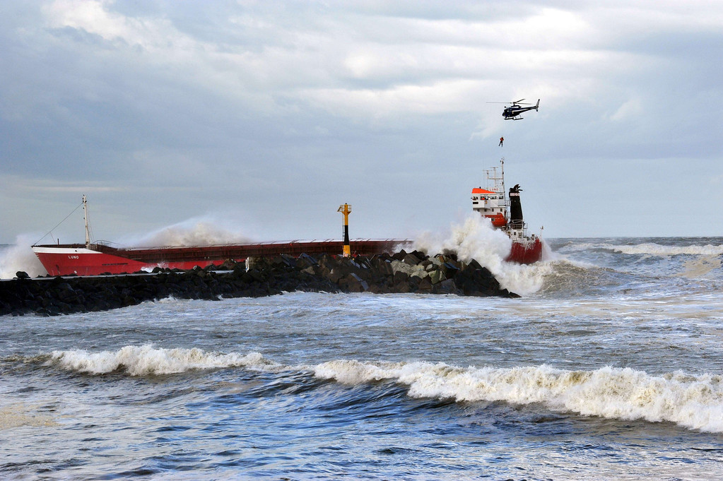 . An helicopter airlifts a crew member over a Spanish cargo ship \'\'Luno\'\' which slammed into a dyke and split in two, injuring at least one sailor and raising concerns of a fuel leak, in Anglet, near the French port of Bayonne, on February 5, 2014. AFP PHOTO/ KEPA ETCHANDY/AFP/Getty Images