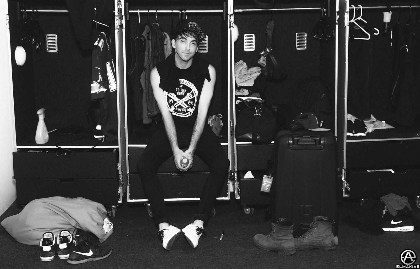 Alex of All Time Low with the bands wardrobes cases after the set by Adam Elmakias