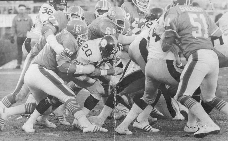 . Broncos linebacker Tom Jackson\'s 2 interceptions and a fumble return set up 17 Denver points as the Broncos defeated the Steelers 34-21.    Football - Denver Broncos (Action) Orange Crush in Action. Steeler\'s Rocky Bleier (20) is Swarmed on by  Barney Chavous (79), Lyle Alzado (77), Rubin Carter (68) and Co. Credit: Denver Post