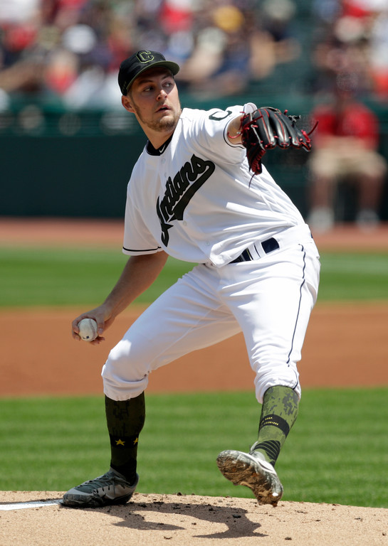 . Cleveland Indians starting pitcher Trevor Bauer delivers in the first inning of a baseball game against the Houston Astros, Sunday, May 27, 2018, in Cleveland. (AP Photo/Tony Dejak)