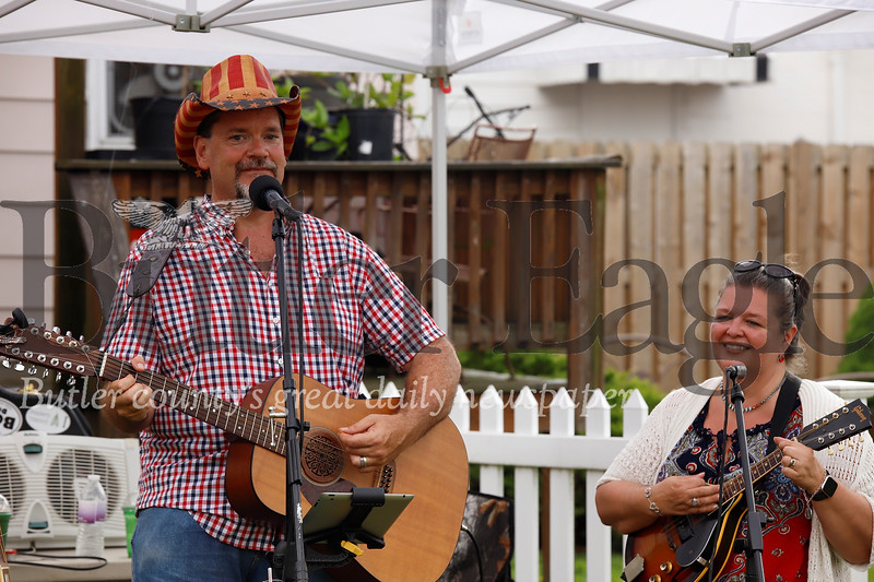 Jim and Debbie Tobin entertained the crowd in Mars before the borough's Fourth of July Parade. Seb Foltz/Butler Eagle