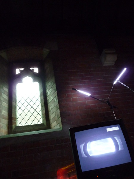 Transference - 2012 - tv monitors - microphone stands - cold cathode