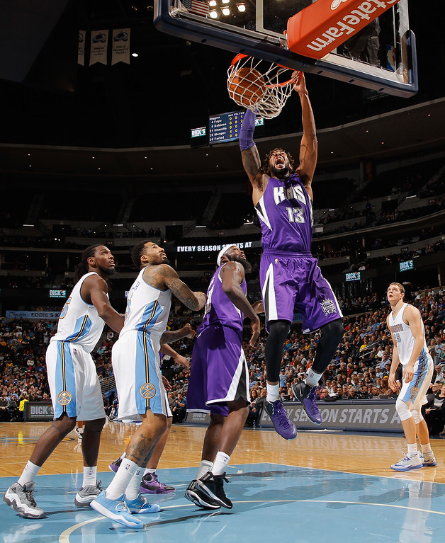 . DENVER, CO - NOVEMBER 03:  Derrick Williams #13 of the Sacramento Kings dunks the ball against the Denver Nuggets at Pepsi Center on November 3, 2014 in Denver, Colorado. NOTE TO USER: User expressly acknowledges and agrees that, by downloading and or using this photograph, User is consenting to the terms and conditions of the Getty Images License Agreement.  (Photo by Doug Pensinger/Getty Images)