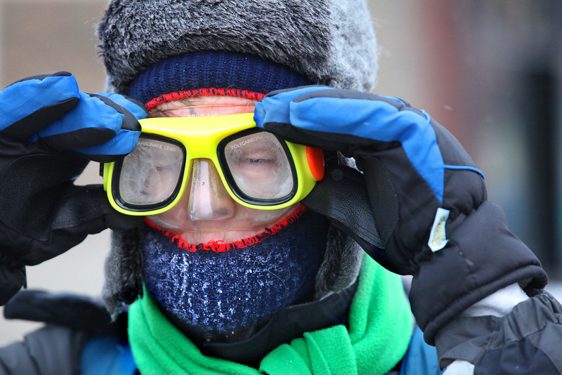 . Wesley Hoague protects himself from the cold with a pair of goggles as he heads to class at Milwaukee Institute of Art and Design (MIAD)  in Milwaukee on Thursday, Jan. 23, 2014. A wind chill advisory from the National Weather Service is in effect until noon on Thursday. (AP Photo/Milwaukee Journal-Sentinel, Mike De Sisti)