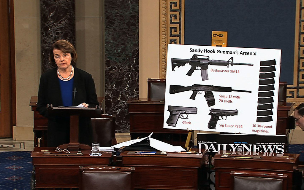 . This video frame grab provided by Senate Television shows Sen. Dianne Feinstein, D-Calif. using a poster of weapons as she speaks about gun legisalation, Wednesday, April 17, 2013, on the floor of the Senate on Capitol Hill in Washington.  A bipartisan effort to expand background checks was in deep trouble Wednesday as the Senate approached a long-awaited vote on the linchpin of the drive to curb gun violence. (AP Photo/Senate Television)