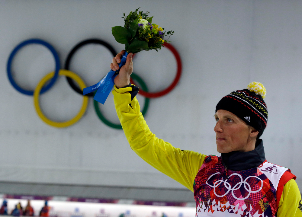 . Germany\'s Erik Lesser celebrates after winning the silver medal in the men\'s biathlon 20k individual race, at the 2014 Winter Olympics, Thursday, Feb. 13, 2014, in Krasnaya Polyana, Russia. (AP Photo/Lee Jin-man)