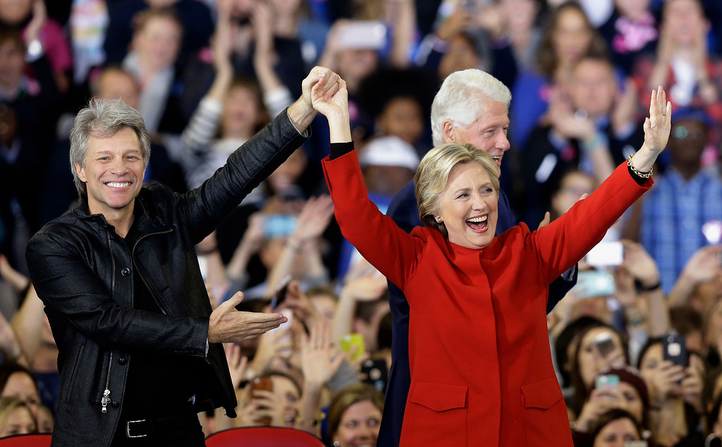 . Democratic presidential candidate Hillary Clinton is joined by Jon Bon Jovi, left, and former President Bill Clinton during a campaign rally in Raleigh, N.C., Tuesday, Nov. 8, 2016. (AP Photo/Gerry Broome)