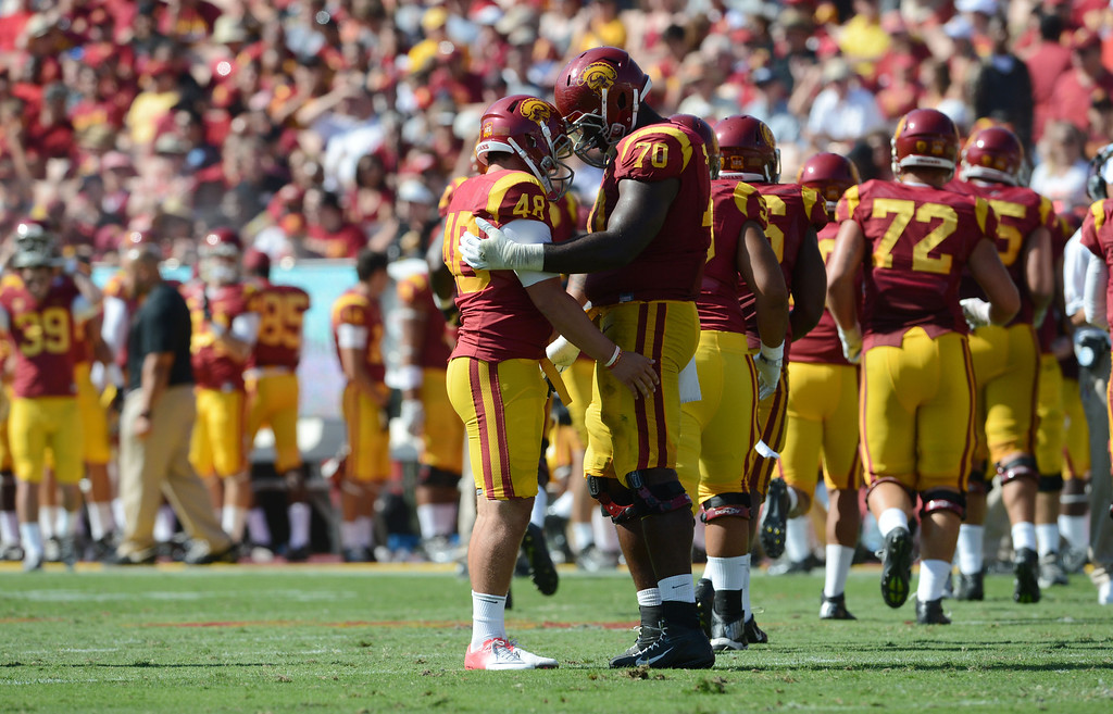 . USC 17, UTAH STATE 14<br /> Sept. 21, 2013; Los Angeles Memorial Coliseum Andre Heidari\'s 25-yard field goal with 13:35 to play proved to be the difference for USC (3-1). The Trojans defense stepped up in this hard-fought game, holding Utah State (2-2) to just 285 yards and 13 first downs. The Aggies came into the game averaging  49.3 points and 550 yards in their first three games. USC tailback Tre Madden failed to reach 100 yards rushing for the fourth straight game, but ran for 93 yards on 24 carries. Cody Kessler threw for 164 yards and a touchdown.   (Stephen Carr/Press-Telegram)