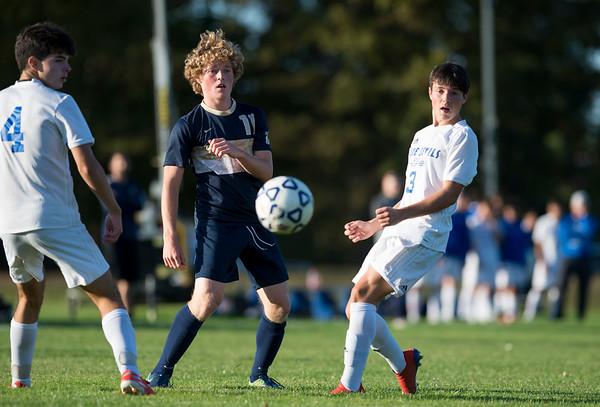 10/15/19 Wesley Bunnell | Staff Plainville boys soccer defeated host Newington 2-1 on Tuesday afternoon. Newington's Ryan Saindon (11) and Plainville's Trevor Rau (3).