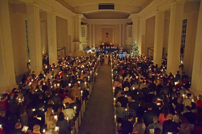 """The singing of """"Silent Night"""" by candlelight at Davidson College Presbyterian Church."""
