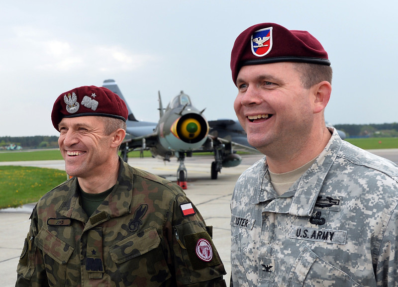 . Polish General Adam Joks and Michael Foster Brigade Commander at 173rd Airborne Brigade smile as first American troops arrived at the airport in Swidwin, Poland on April 23, 2014, after Washington said it was sending a force of 600 to the Baltic states as the crisis over Ukraine deepens . (JANEK SKARZYNSKI/AFP/Getty Images)