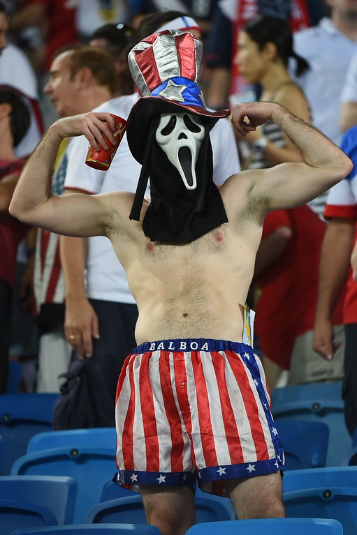 . An US fan cheers before a Group G football match between Ghana and US at the Dunas Arena in Natal during the 2014 FIFA World Cup on June 16, 2014. AFP PHOTO / EMMANUEL  DUNAND/AFP/Getty Images