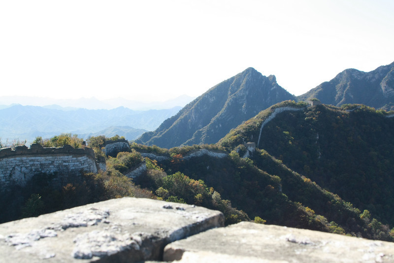 the Jian Kou great wall seems to be disappearing into the mountain.