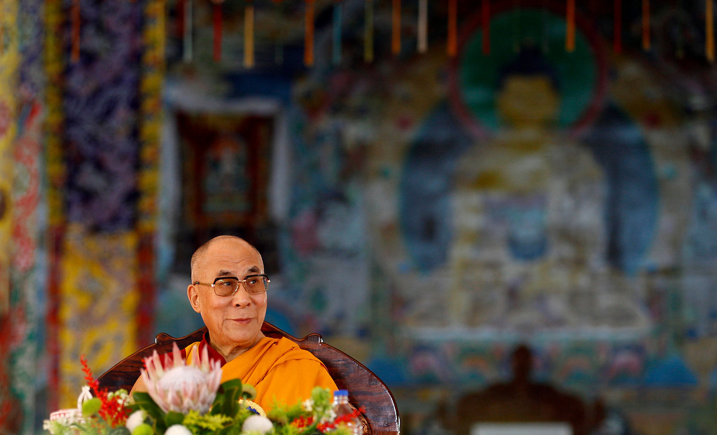 . Tibetan spiritual leader the Dalai Lama listens to a speaker during an event organized to celebrate his 78th birthday at a Tibetan Buddhist monastery in Bylakuppe, about 220 kilometers (137 miles) southwest of Bangalore, India, Saturday, July 6, 2013. (AP Photo/Aijaz Rahi)