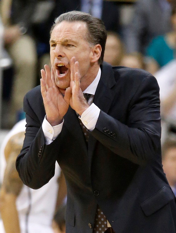 . Pittsburgh coach Jamie Dixon yells to his team during the first half of an NCAA college basketball game against Syracuse on Wednesday, Feb. 12, 2014, in Pittsburgh. Syracuse won 58-56. (AP Photo/Keith Srakocic)