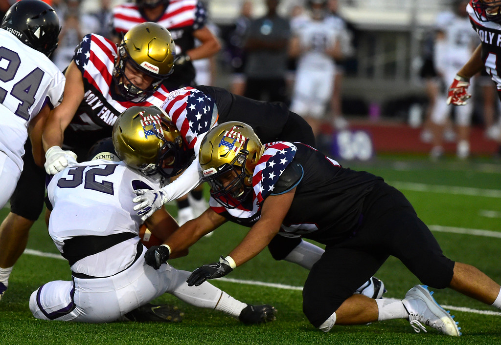 . BROOMFIELD CO - SEPTEMBER 14 2018 Holy Family High School\'s Matt Delgado and Jack Bertagnolli take down Discovery Canyon High\'s Kevin Pasion during their game in Broomfield on Friday September 14, 2018. More photos bocopreps.com  (Photo by Paul Aiken/Staff Photographer)