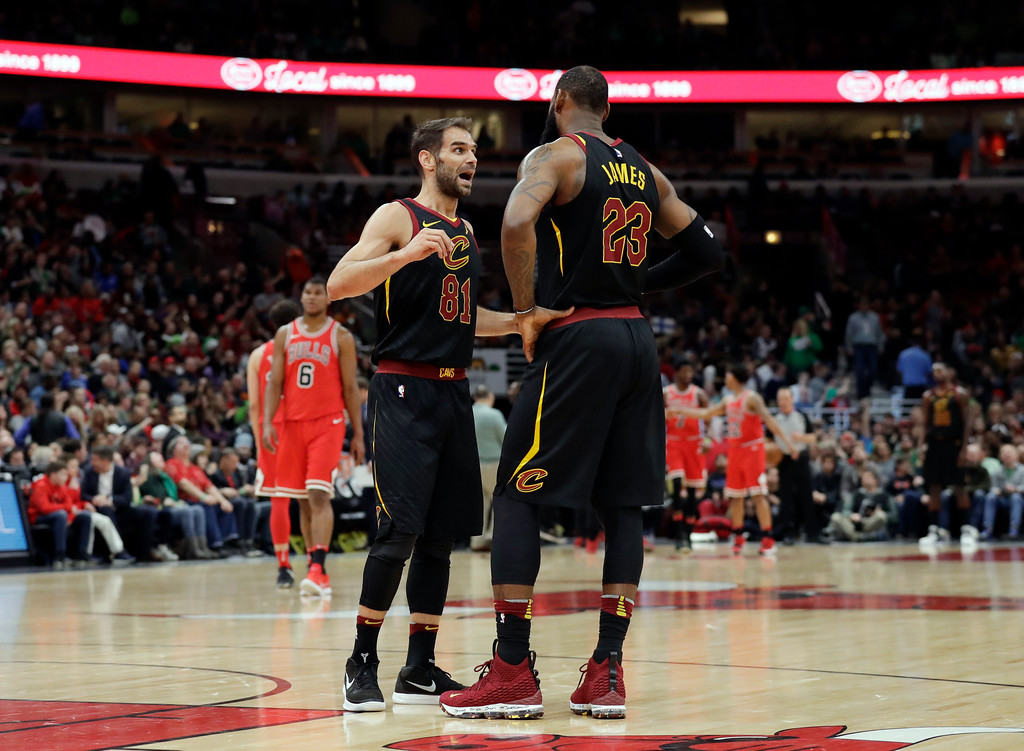 . Cleveland Cavaliers guard Jose Calderon, left, talks with forward LeBron James during the first half of an NBA basketball game against the Chicago Bulls, Saturday, March 17, 2018, in Chicago. (AP Photo/Nam Y. Huh)