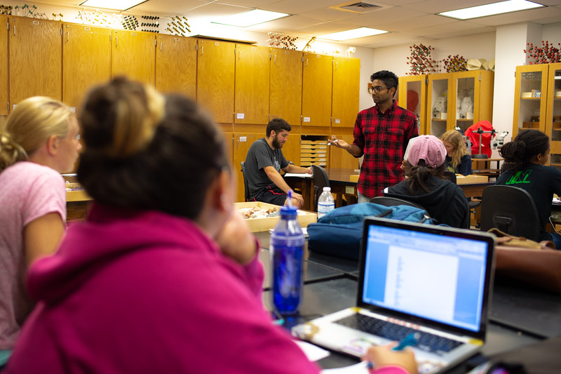 Graduate assistant Mr. Abdullajintakam lectures students on identifying minerals for their Mineralogy Lab.