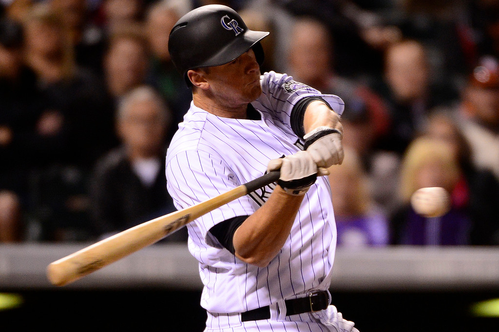 . DENVER, CO - APRIL 12: Colorado Rockies second baseman DJ LeMahieu (9) swings at a pitch during the fifth inning at Coors Field on April 12, 2016 in Denver, Colorado. (Photo by Brent Lewis/The Denver Post)
