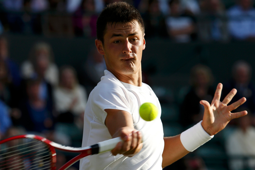 . Bernard Tomic of Australia hits a return to Tomas Berdych of the Czech Republic in their men\'s singles tennis match at the Wimbledon Tennis Championships, in London July 1, 2013.    REUTERS/Suzanne Plunkett