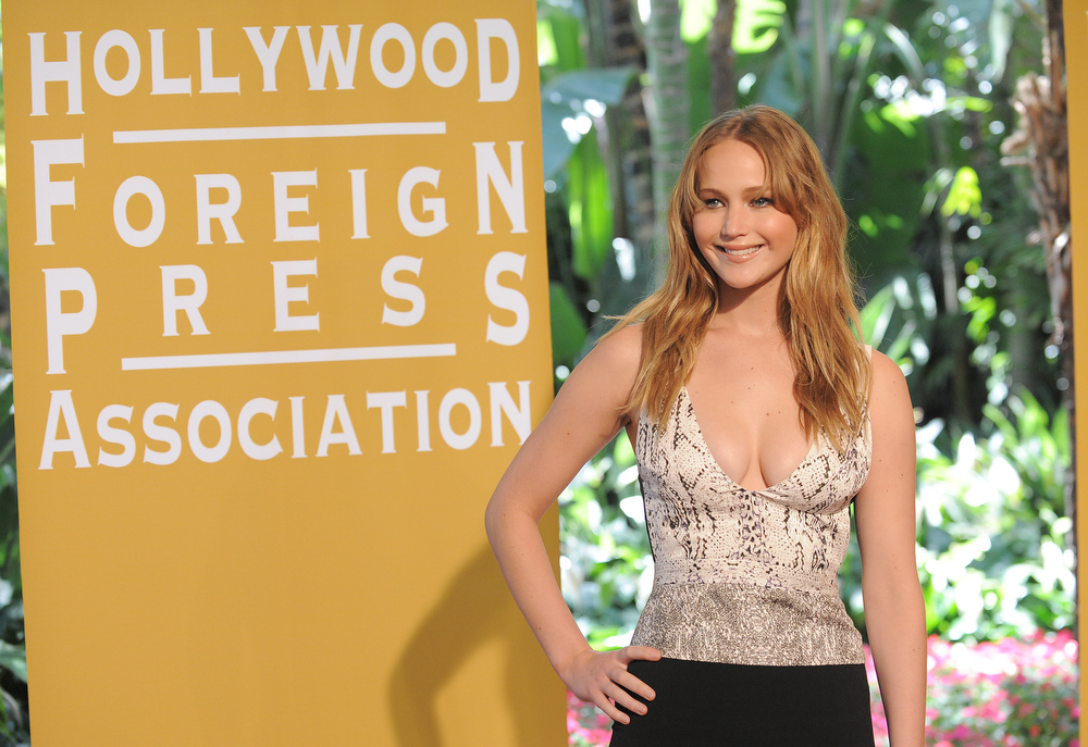 Description of . Jennifer Lawrence attends the Hollywood Foreign Press Association luncheon at the Beverly Hills Hotel on Thursday, Aug. 9, 2012, in Beverly Hills, Calif. (Photo by Jordan Strauss/Invision/AP)