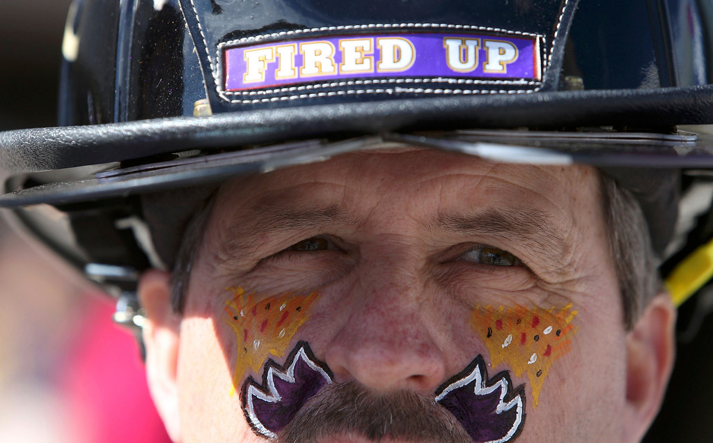 . A Baltimore Ravens fan stands outside the Superdome before the NFL Super Bowl XLVII football game against the San Francisco 49ers in New Orleans, Louisiana, February 3, 2013. REUTERS/Sean Gardner