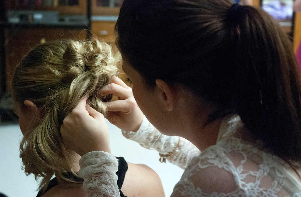 . Kayla Rice/Reformer 2013 Winter Carnival Queen Alison Cornellier gets her hair done backstage during the intermission of the 2014 Brattleboro Winter Carnival Queen\'s Pageant on Friday evening.