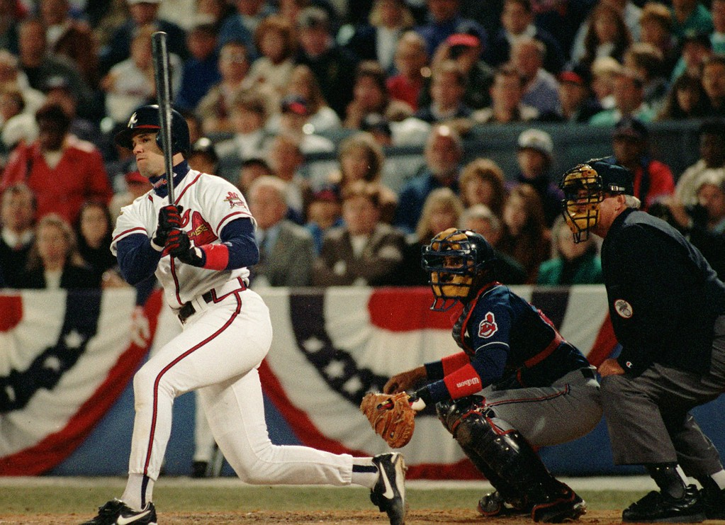 . Atlanta Braves Javier Lopez watches his sixth inning two-run homer in Game Two of the World Series in Atlanta Sunday, Oct. 22, 1995. Cleveland Indians catcher Tony Pena and plate umpire Jim McKean look on. The Braves took a 2-0 lead in the series with their 4-3 victory. (AP Photo/Mark Duncan)