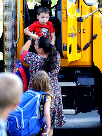 9/3/2019 Mike Orazzi | StaffrNicole Nass helps her son Caleb after he got a ride to school from Public Works to the West Bristol School on the first day of school Tuesday morning in Bristol.
