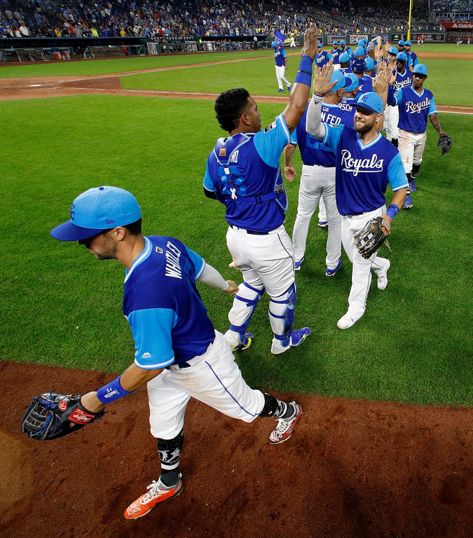 . Kansas City Royals celebrate after a baseball game against the Cleveland Indians on Saturday, Aug. 25, 2018, in Kansas City, Mo. The Royals won 7-1. (AP Photo/Charlie Riedel)