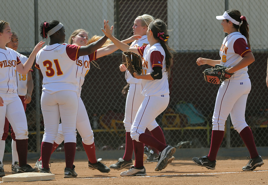 . 05-16-2013-( Daily Breeze Staff Photo by Sean Hiller) Wilson vs. El Toro in the opening round of the CIF-SS D2 playoffs Thursday at Joe Rodgers Field in Long Beach. Wilson celebrate a third out caught by Kori Cochran(11).
