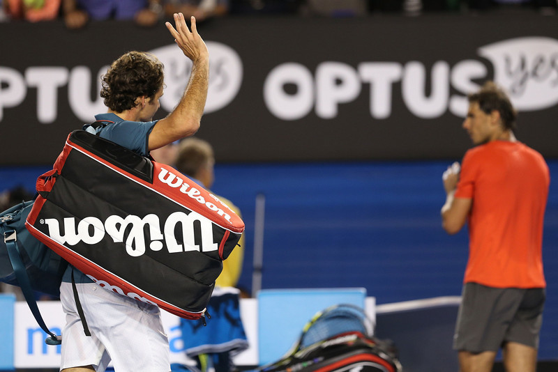 . Roger Federer of Switzerland leaves the court after losing his semifinal match against Rafael Nadal of Spain during day 12 of the 2014 Australian Open at Melbourne Park on January 24, 2014 in Melbourne, Australia.  (Photo by Clive Brunskill/Getty Images)
