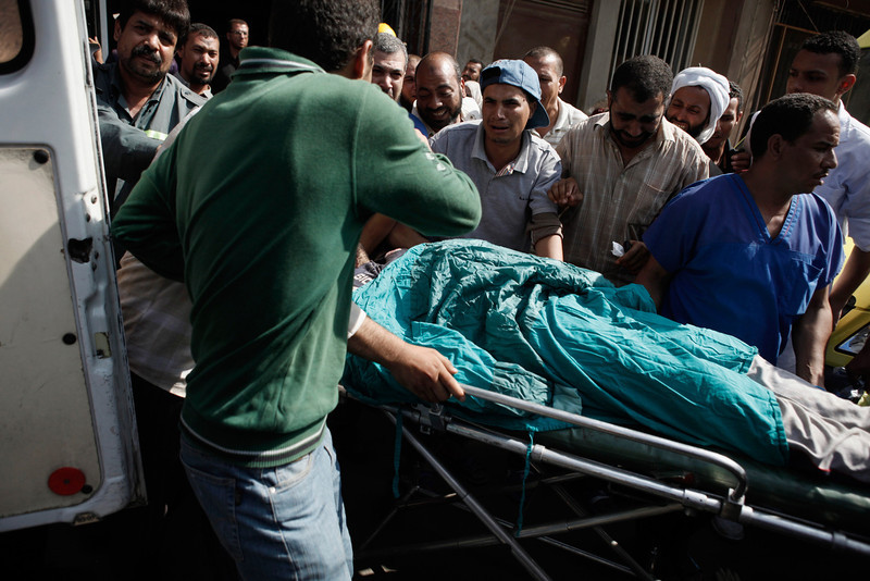 . The body of a man is carried on a stretcher at the Liltaqmeen al-Sahy Hospital in Cairo\'s Nasr City district, after allegedly being killed during a shooting at the site of a pro-Morsi sit-in in front of the headquarters of the Egyptian Republican Guard on July 8, 2013 in Cairo, Egypt. Egyptian health ministry officials are reporting at least 42 people were killed and more than 300 injured in the incident early on Monday morning, which allegedly occurred as supporters of deposed Egyptian President Mohammed Morsi attending the sit in were performing dawn prayer. The demonstrators were demanding the release of Morsi, who they believe is being held inside the Republican Guard headquarters. (Photo by Ed Giles/Getty Images)
