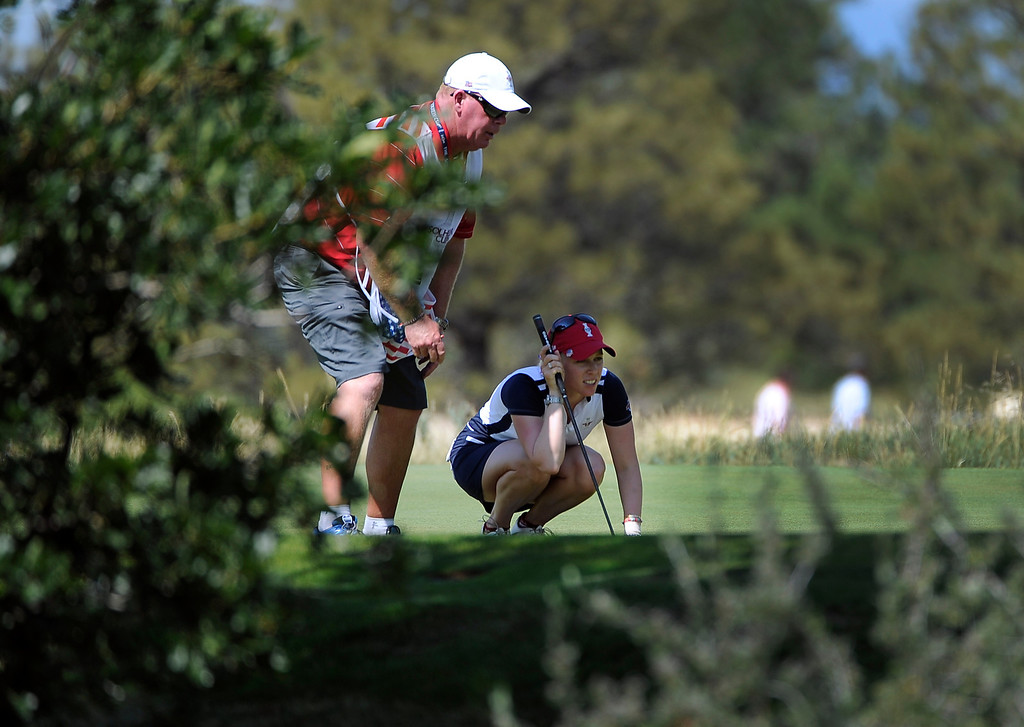 . PARKER, CO - Aug.17: Team USA\'s Morgan Pressel lines up her shot on the 15th hole. The 2013 Solheim Cup takes place at the Colorado Golf Club with the USA taking on Europe in the Saturday morning Foursomes Match. (Photo By Kathryn Scott Osler/The Denver Post)