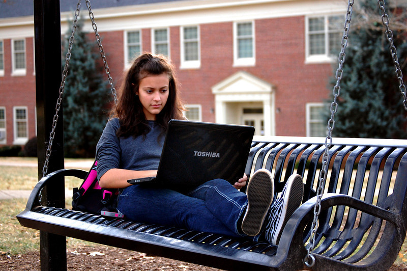 Student studying in the Quad on a fall afternoon.