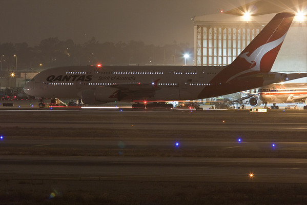 Airbus 380 and other planes at night at LAX