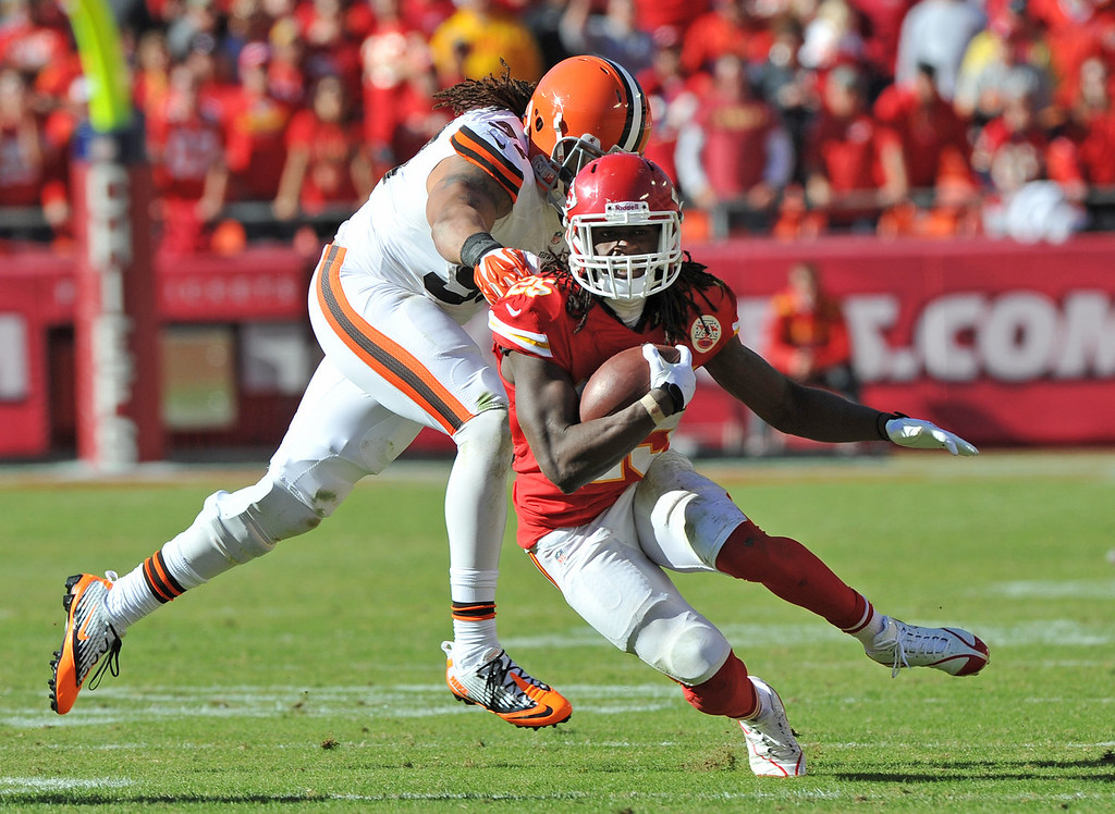. Running back Jamaal Charles #25 of the Kansas City Chiefs rushes past linebacker Jabaal Sheard #97 of the Cleveland Browns during the second half on October 27, 2013 at Arrowhead Stadium in Kansas City, Missouri.  Kansas City won 23-17. (Photo by Peter Aiken/Getty Images)
