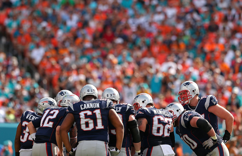 . Tom Brady #12 of the New England Patriots calls a play during a game against the Miami Dolphins at Sun Life Stadium on December 15, 2013 in Miami Gardens, Florida.  (Photo by Mike Ehrmann/Getty Images)