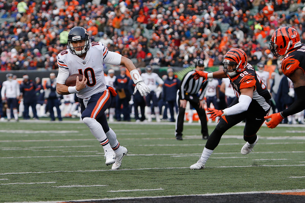 . Chicago Bears quarterback Mitchell Trubisky (10) runs in for a touchdown against Cincinnati Bengals linebacker Jordan Evans (50) in the second half of an NFL football game, Sunday, Dec. 10, 2017, in Cincinnati. (AP Photo/Frank Victores)