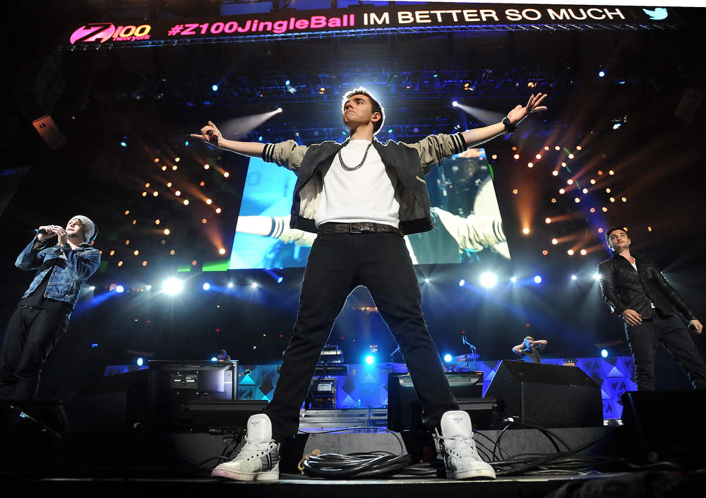 Description of . Singer Nathan Sykes, center, and the rest of the group The Wanted perform at Z100's Jingle Ball 2012 presented by Aeropostale at Madison Square Garden on Friday Dec. 7, 2012 in New York. (Photo by Evan Agostini/Invision/AP)