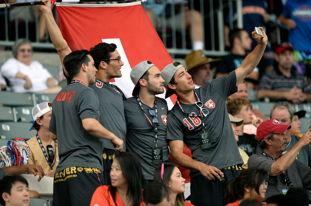 . Swiss players took a selfie in the stands Thursday night. The United States took on Canada in the opening game of the FIL World Lacrosse Championships Thursday night, July 10, 2014.   Photo by Karl Gehring/The Denver Post