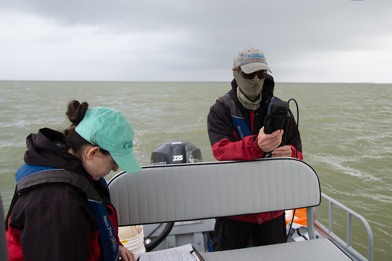 Hannah Ehrmann (left) and Terry Palmer collect data on water salinity and temperature in Baffin Bay.