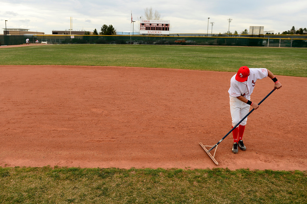 . PARKER, CO - APRIL 29: Regis Jesuit shortstop Brody Weiss rakes his spot on the field following the team\'s final home game. Weiss is the son of Colorado Rockies manager Walt Weiss. (Photo by AAron Ontiveroz/The Denver Post)