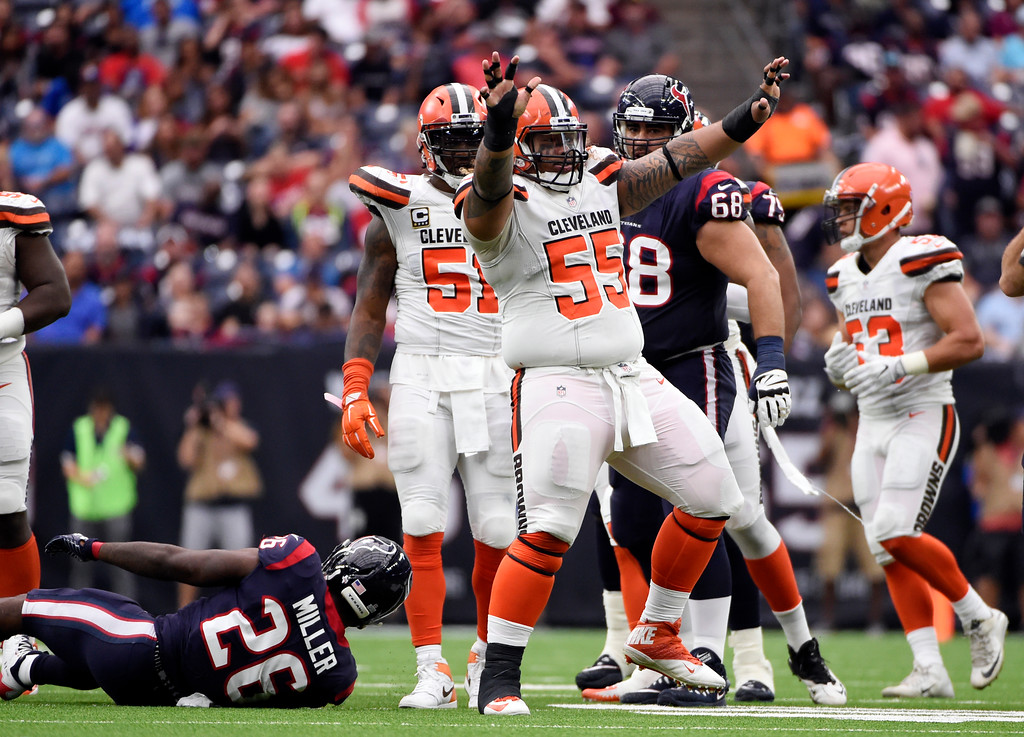 . Cleveland Browns nose tackle Danny Shelton (55) celebrates stopping Houston Texans running back Lamar Miller (26) in the second half of an NFL football game, Sunday, Oct. 15, 2017, in Houston. (AP Photo/Eric Christian Smith)