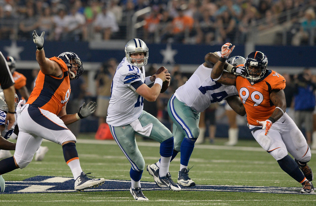 . ARLINGTON, TX - AUGUST 28: Dallas Cowboys quarterback Dustin Vaughan (10) is gets pressure from Denver Broncos defensive tackle Kevin Vickerson (99) during the third quarter  August 28, 2014 at AT&T Stadium. (Photo by John Leyba/The Denver Post)