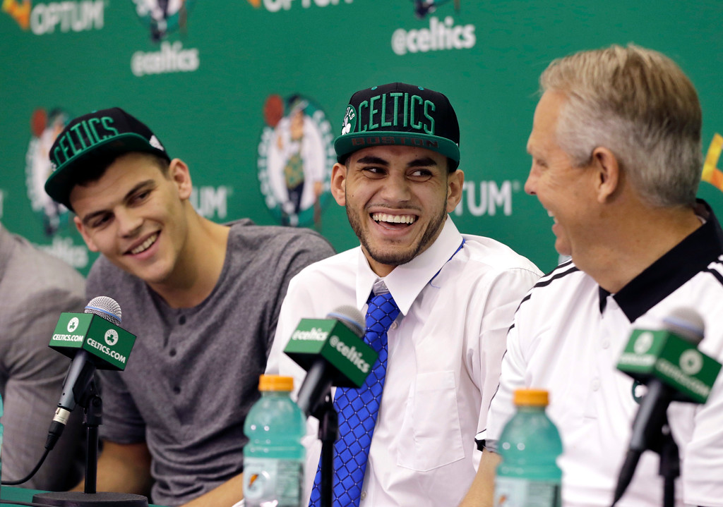 . Boston Celtics  basketball draft picks Ante Zizic, left, of Croatia, and Abdel Nader, center, of Egypt, laugh with Danny Ainge, Celtics president of basketball operations, during an introductory news conference Friday, June 24, 2016, in Waltham, Mass. (AP Photo/Elise Amendola)